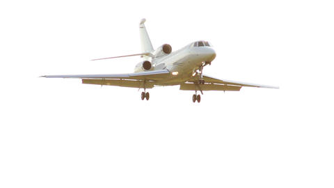 White airplane flies through sun rays, bright aircraft in air Footage