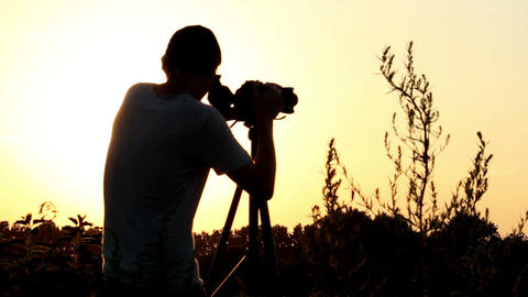 Photographer videographer shoots at dusk, camera viewfinder Footage
