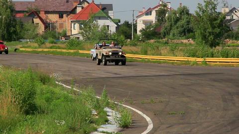 Soviet Russian Moskvitch 412, Toyota Landcruiser, Volkswagen Beetle racing Footage
