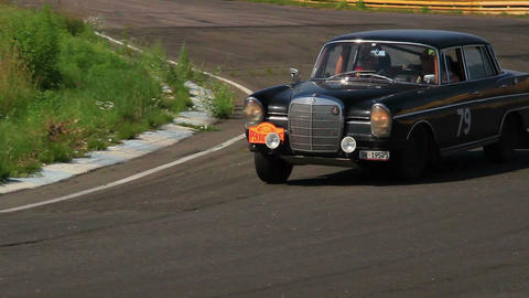 Black classic Mercedes Benz 300 SE turning on the road Footage
