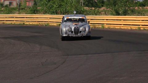Full HD shot of vintage car Jaguar MkII. Peking to Paris international rally Footage