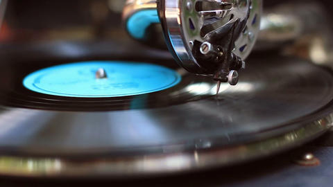 Retro gramophone playing, big fashionable needle scrapes record making music Footage