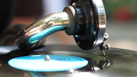 Bright colored vintage turntable, gramophone in city, daytime. Retro style Footage