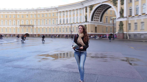 Tourist girl confidently go at Palace Square hold map and enjoy sights Footage