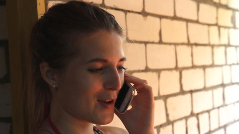 Girl talking on the phone and smiling 2 Footage