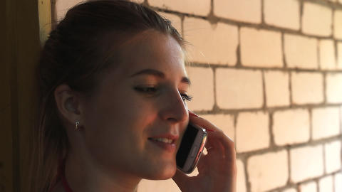 Girl talking on the phone and smiling Footage