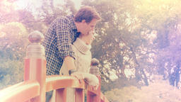 Young couple in 20s cuddle romantically outside - color graded footage Live Action
