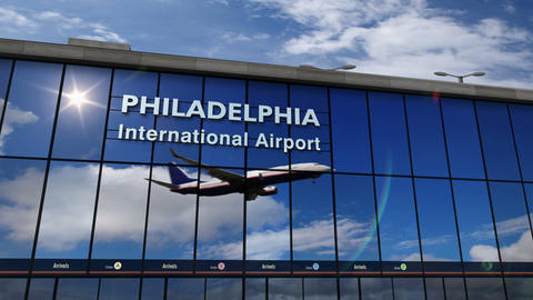 Airplane landing at Philadelphia mirrored in terminal Live Action