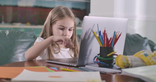 Concentrated Caucasian girl typing on laptop keyboard. Education, e-learning Live Action