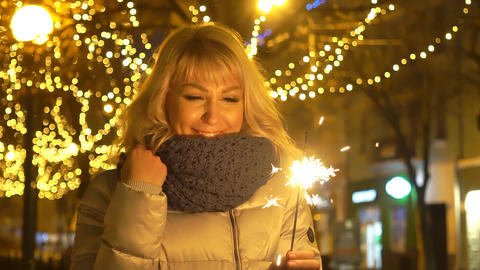 Young Beautiful Happy Smiling Woman Holding Sparkler On The Street. Holiday Live Action