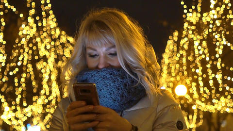 Woman Using Smart Phone At Night In City Live Action