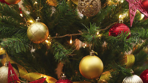 Close up stop motion animation of hand putting Christmas ornament on the Christmas tree Animation