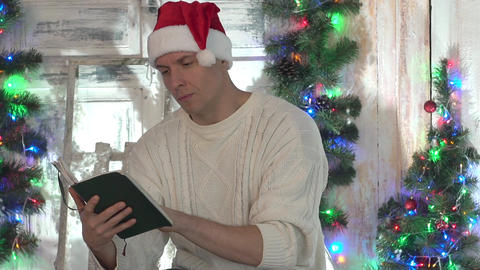 Handsome Man Looking At Book As Christmas Gift Live Action