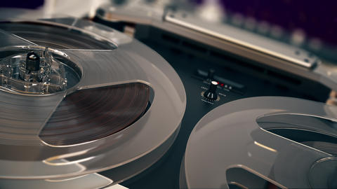 Closeup shot of spinning reels on old analogue reel-to-reel audio tape recorder Animation