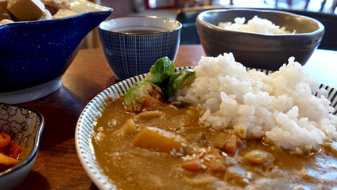 Asian pork curry with other dishes Live Action
