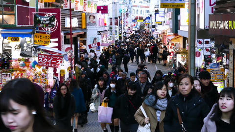 Unidentified people walk along Takeshita street in Harajuku, a famous Japanes Live Action