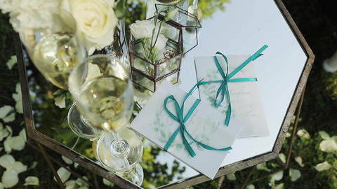 Close-up of two wedding rings on a flowers background. Beautiful wedding decor Live Action