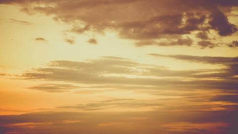 The movement of golden clouds on the orange sky. The motion of a dragging cloud on a dark yellow Live Action