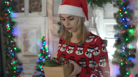 Christmas, Holidays And Presents Concept - Woman In Santa Hat Holding Gift Bo Live Action