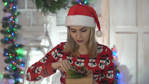 Young Woman Holding And Open Holiday Present In Hands For Christmas Live Action
