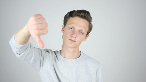 Thumbs Down, Failure, Disagree, Isolated Gesture by Young Man Footage