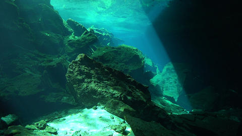 An underwater cave illuminated by rays of sunlight Footage