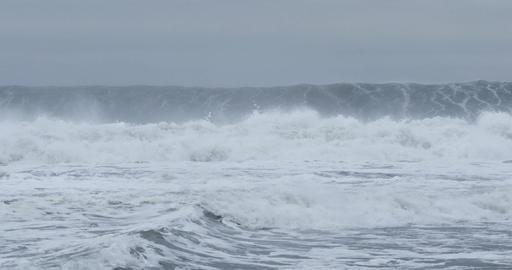 Big ocean sea waves crashing on coastal rocks during storm Footage