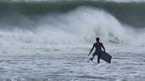 NSW, AUSTRALIA - JUNE 2016: bodyboarder surfer big stormy sea waves from cyclone Footage