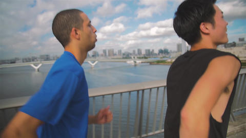 Japanese and international Runners exercising on Tokyo bridge skyline Background Footage