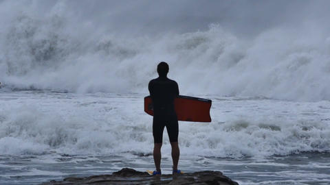 NSW, AUSTRALIA - JUNE 2016: bodyboarder surfer storm sea swells white wash Footage