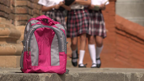 Female Students Walking Towards Backpack Footage