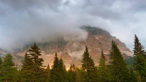 Fog and Clouds in the Mountains. Time Lapse UHD Footage