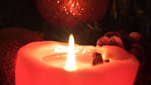 Candles On The Background Of Garlands Blinking. Christmas Still Life Live Action