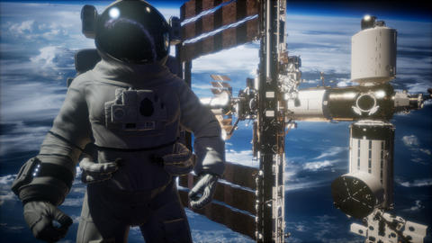 International Space Station and astronaut in outer space over the planet Earth Live Action