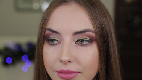 Portrait of a beautiful happy girl with make-up in a beauty salon Live Action
