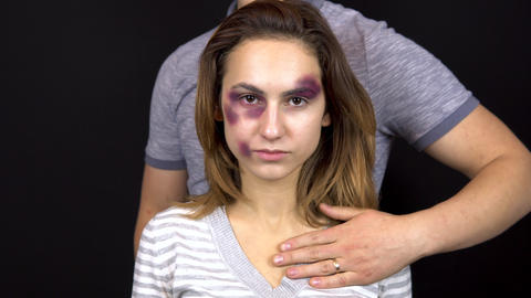 A young man stroking a young woman. A woman with bruises on her face. Quarrel in Live Action