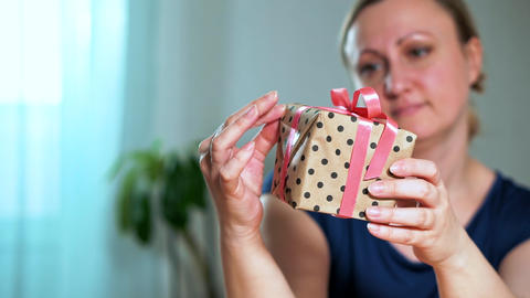 Close-up of a woman holding a gift Live Action
