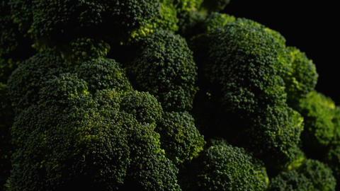 Close up of broccoli rotating against black background Live Action