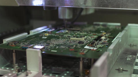 Circuit Board Assembly. SMT (Pick-and-place) Machine mounting an Electronic Circuit Board in the Live Action