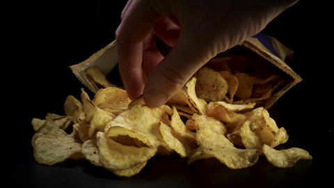 Hand picking delicious potato chips - Junk food Live Action