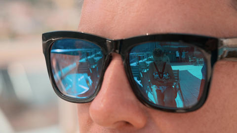 Close-up partial view of man in sunglasses during vacation Live Action