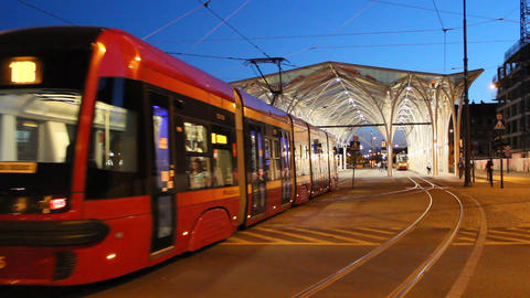 night tram riding around city. Modern tram going in evening city Live Action