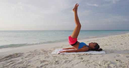 Fitness woman training working out outdoors on beach Live Action