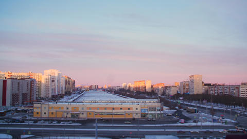 Timelapse beautiful sunset with colorful sky in modern city. Blue and pink sky Live Action