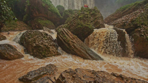 Cascade of Stormy Mountain Brown Water River among Stones Footage