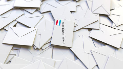 Letter with From Luxembourg text on pile of other Letters. International mail Live Action