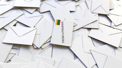 Letter with From Lithuania text on pile of other Letters. International mail Live Action