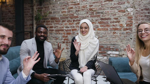 Happy smiling young successful multi ethnic business people making gesture OK Live Action