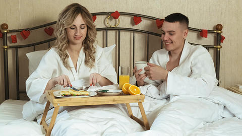 Young couple lovers romantic breakfast in bed Live Action