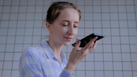 Woman holding smartphone and using voice recognition function Live Action